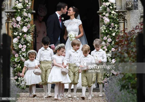 Pippa Middleton kisses her new husband James Matthews following their wedding ceremony at St Mark's Church as the bridesmaids and pageboys walk ahead...