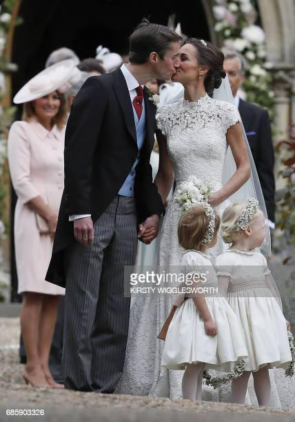 Pippa Middleton kisses her new husband James Matthews following their wedding ceremony at St Mark's Church in Englefield west of London on May 20...