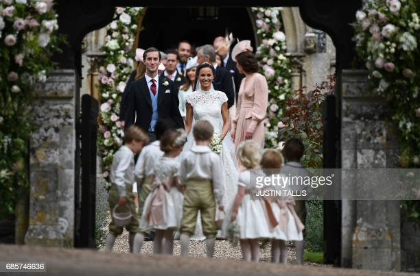 TOPSHOT Pippa Middleton poses for a photograph with her new husband James Matthews following their wedding ceremony at St Mark's Church in Englefield...