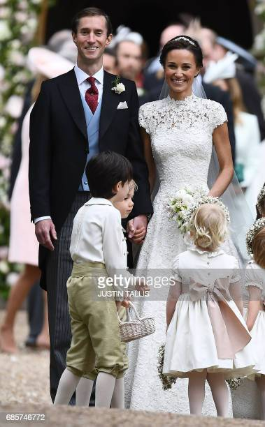Pippa Middleton poses for a photograph with her new husband James Matthews following their wedding ceremony at St Mark's Church in Englefield west of...