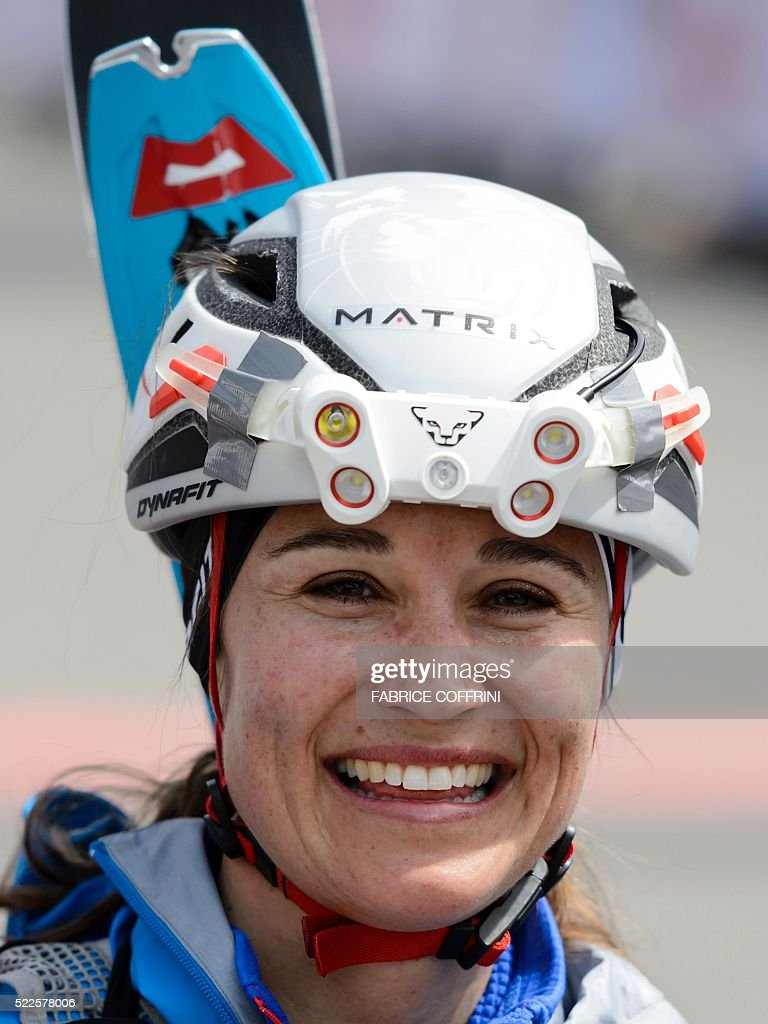 Pippa Middleton smiles after crossing the finish-line of the 'Patrouille des Glaciers' (Glacier Patrol) ski mountaineering race in Verbier on April 20, 2016. Pippa Middleton competed in a team of three racers at the Patrouille des Glaciers organised every two years by the Swiss Army that sees highly-experienced hiker-skiers trek across the Haute Route along the Swiss-Italian border from Zermatt to Verbier. The race covers 53kms (31.8 miles) by foot and ski, with over 7000m gained and lost along the way. / AFP / FABRICE