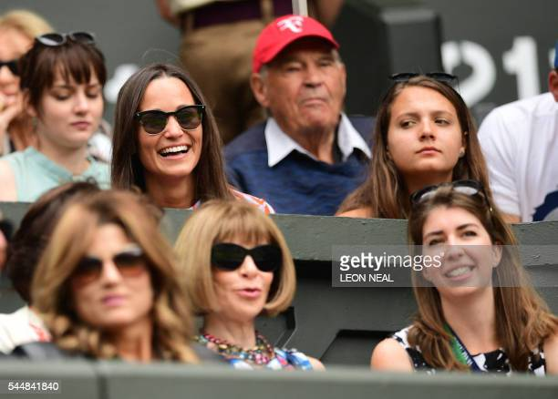 Pippa Middleton smiles by Mirka Federer wife of Roger Federer and US Vogue editor Anna Wintour on centre court on the eighth day of the 2016...