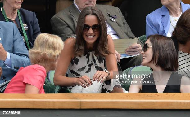 Pippa Middleton talks to Gill Brook and Michelle Dockery in the Royal Box on Centre Court