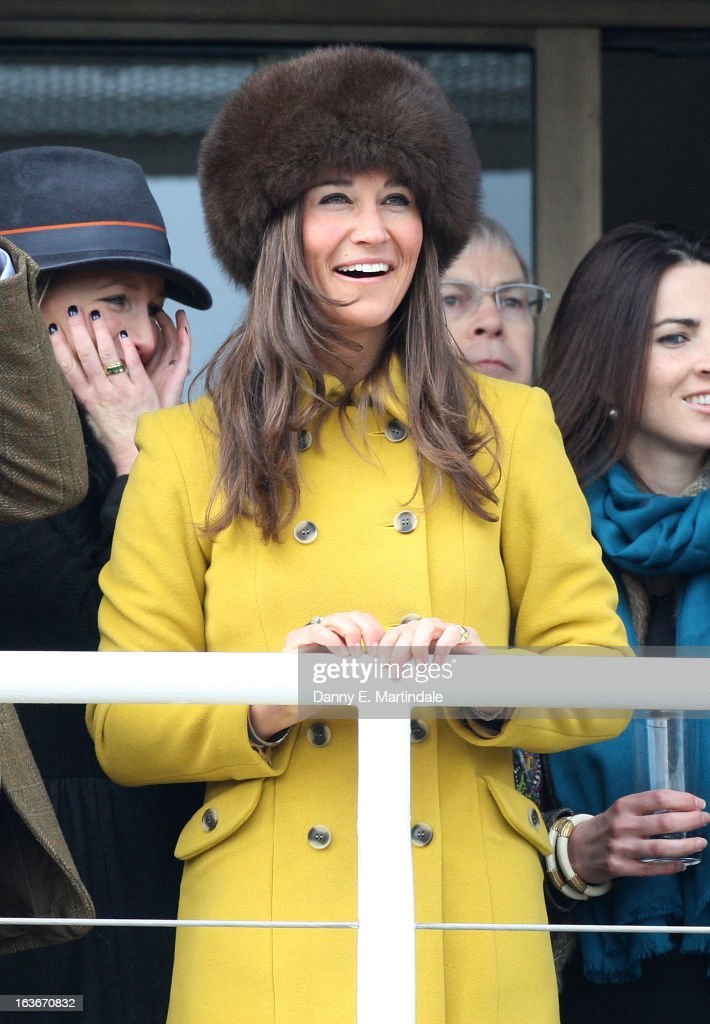 Pippa Middleton watches day 3 of the Cheltenham Festival at Cheltenham Racecourse on March 14, 2013 in Cheltenham, England.