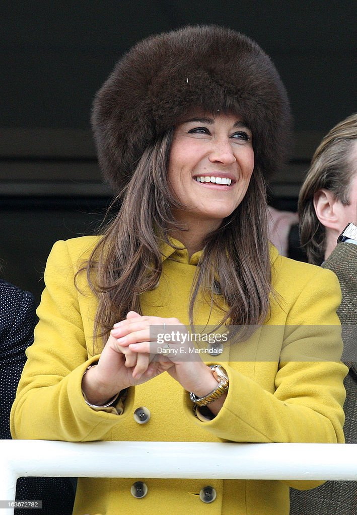 Pippa Middleton watches the Queens Mother Champion Steeple Chase on day 3 of the Cheltenham Festival at Cheltenham Racecourse on March 14, 2013 in Cheltenham, England.