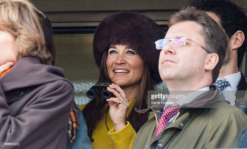 Pippa Middleton watches the races as she attends day 3 of the Cheltenham Festival at Cheltenham racecourse on March 14, 2013 in London, England.