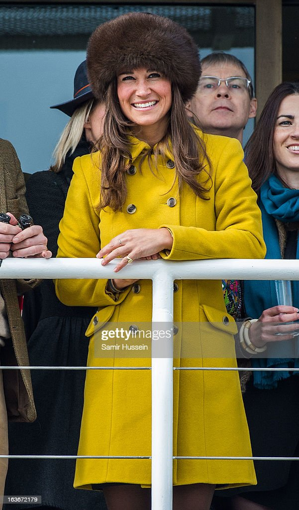 Pippa Middleton watches the races from the balcony at the Cheltenham Festival Day 3 at Cheltenham racecourse on March 14, 2013 in London, England.