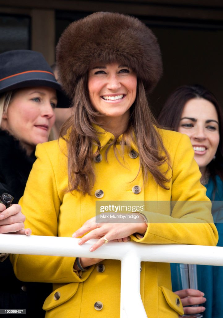 Pippa Middleton watches the racing as she attends Day 3 of The Cheltenham Festival at Cheltenham Racecourse on March 14, 2013 in London, England.