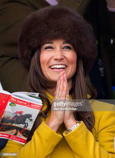 Pippa Middleton watches the racing as she attends Day 3 of The Cheltenham Festival at Cheltenham Racecourse on March 14 2013 in London England
