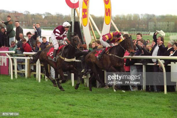 Pipped at the post in the Scottish Grand National Lady jockey Gee Armytage on Merry Master is beaten by Mark Perrett on Run For Free at Ayr...