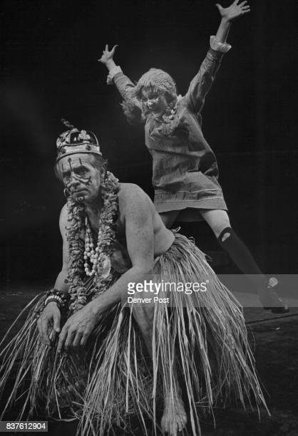 Pippi leaps for joy and prepares to be whisked away by her cannibal king father played by Frank Chalmers at the happy conclusion of 'Pippi Long...