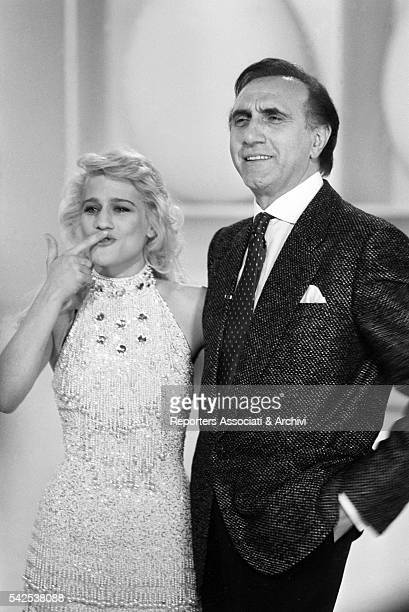 Pippo Baudo Italian TV host with Heather Parisi actress and showgirl during a break on the set of TV show 'Fantastico 5' broadcasting from Teatro...