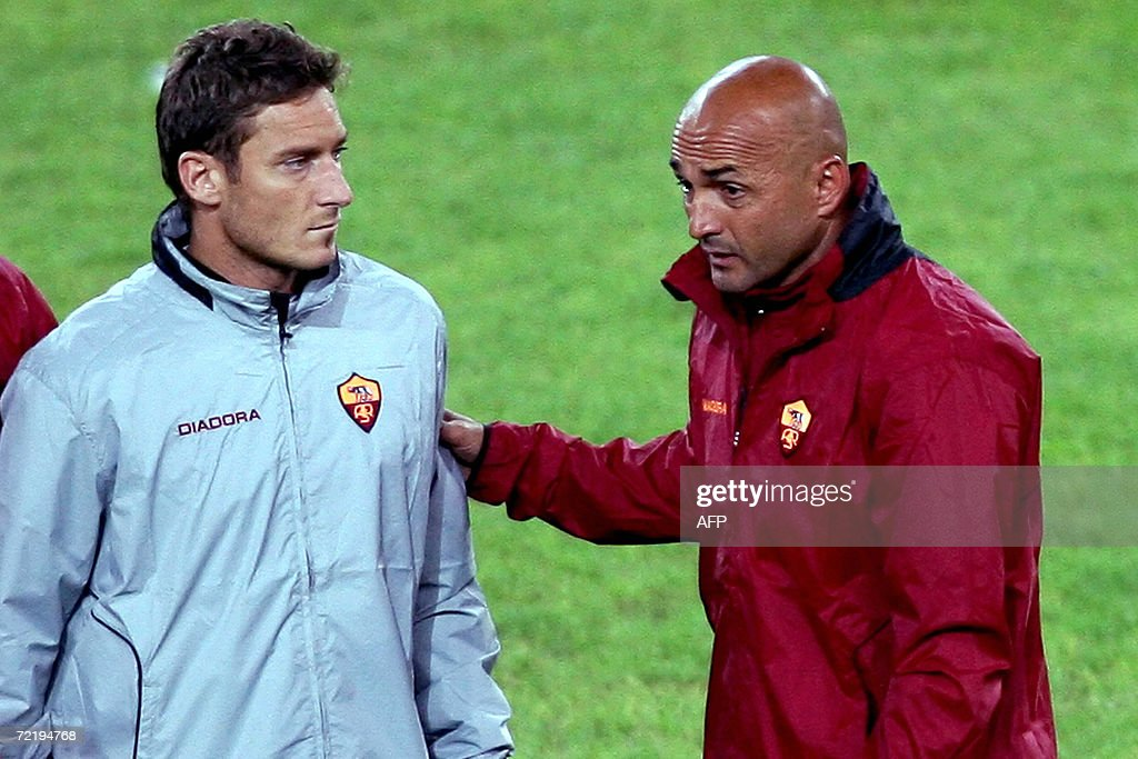 Roma's coach Luciano Spalletti (R) speaks to striker <a gi-track='captionPersonalityLinkClicked' href=/galleries/search?phrase=Francesco+Totti&family=editorial&specificpeople=208985 ng-click='$event.stopPropagation()'>Francesco Totti</a> during a trainning session on the eve of the Champions league group D football match against Olympiakos at Karaiskaki stadium in Piraeus, near Athens, 17 October 2006. AFP PHOTO / Aris Messinis