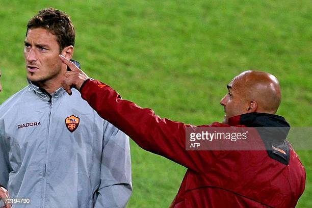 Roma's striker Francesco Totti speaks with his coach Luciano Spalletti during a trainning session on the eve of the Champions league group D football...