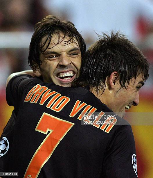Valencia 's Fernando Morientes celebrates his goal with his teammate David Villa during their group D Champions league match at the Karaiskaki...