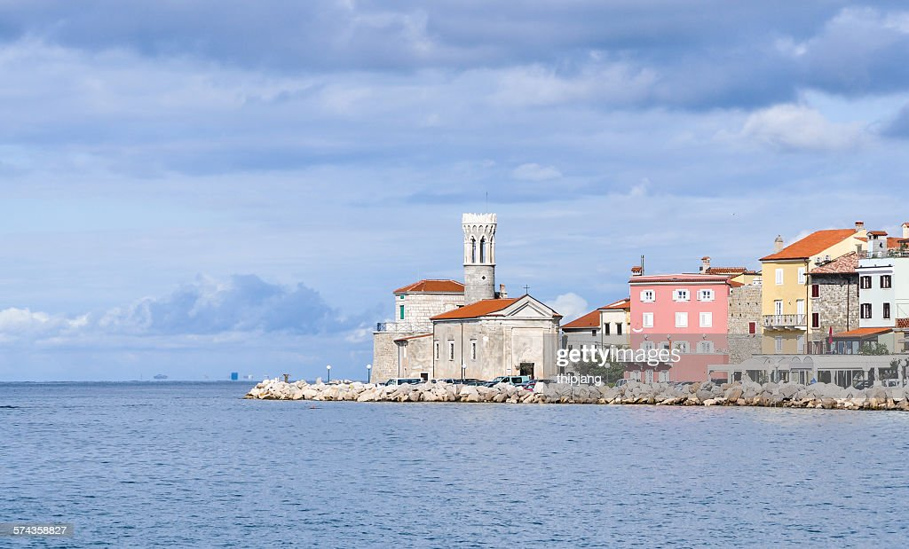 Piran lighthouse and houses at the waterfront