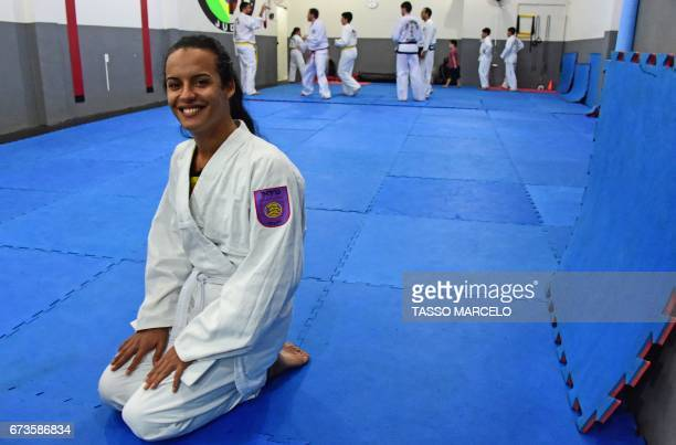 CORRECTION 'Piranha Team' member trans Lara Lincom before participating in a krav maga selfdefence technique class in Rio de Janeiro Brazil on April...