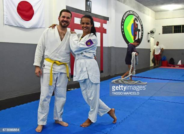 CORRECTION 'Piranha Team' members gay Halisson Paes and trans Lara Lincom pose before participating in a krav maga selfdefence technique class in Rio...