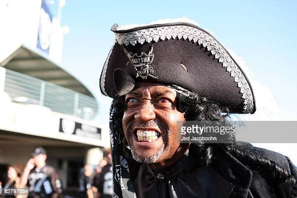 A pirate costumed fan of the Oakland Raiders shows his support prior to the NFL game against the Denver Broncos on September 8 2008 at McAfee...