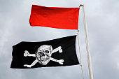 Pirate flag below red flag