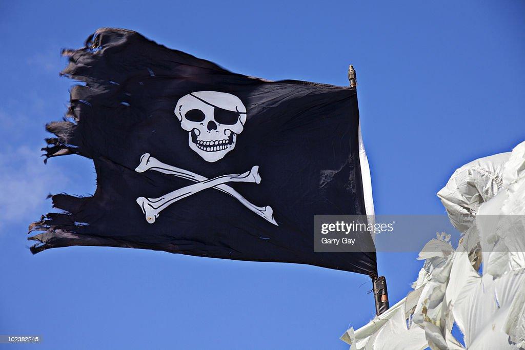 Pirate flag skull and cross bones : Stock Photo