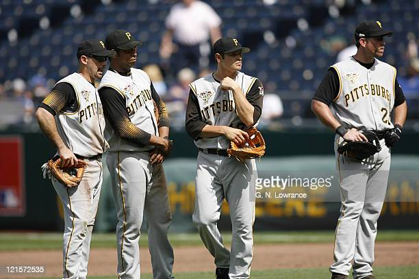 Pirate infielders Jake Wilson Jose Castillo Freddy Sanchez and Sean Casey wait during a pitching change in action between the Pittsburgh Pirates and...