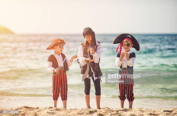 Pirate kids enjoying their treasure