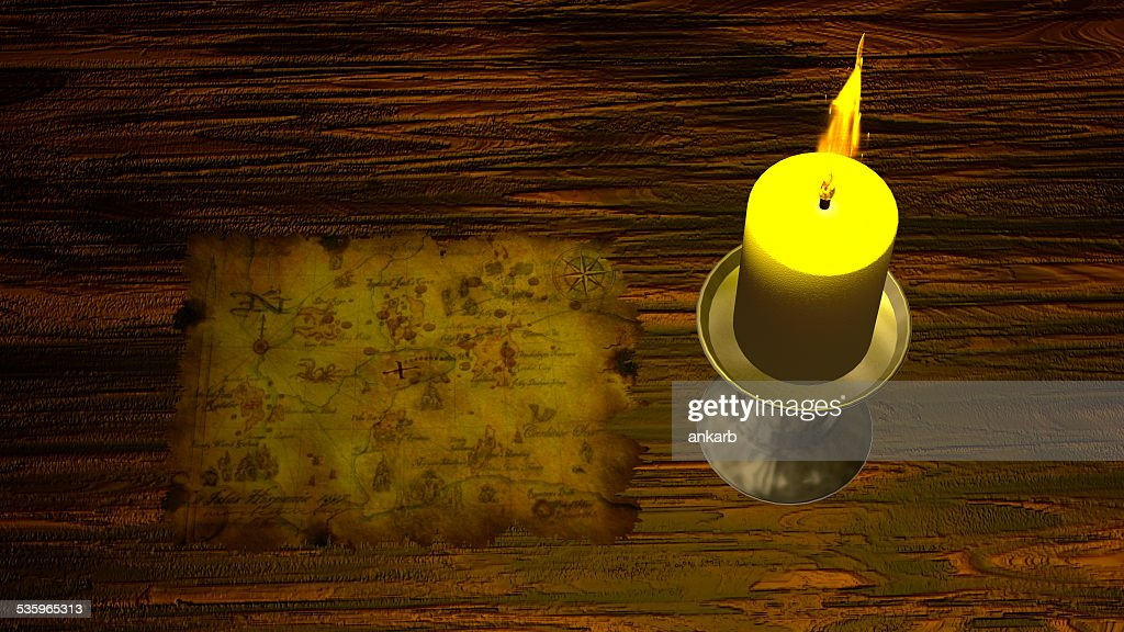 Pirate Map under Candle Light : Stock Photo