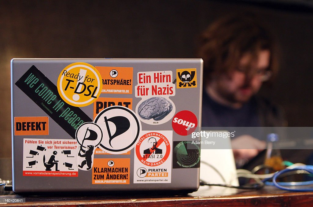 A Pirate Party supporter types on a table computer next to a laptop computer covered in stickers during a meeting of the Berlin chapter of the party on February 23, 2013 in Berlin, Germany. After successes in 2011 in regional elections in the German capital and in the following year in the states of Schleswig-Holstein and North Rhine-Westphalia, the German Pirate Party (Piratenpartei), which initially focused on filesharing, censorship and data protection, has seen two of its state-level leaders in the states of Brandenburg and Baden-Wuerttemburg step down in the past few days alone. The party's Berlin representation is meeting over the weekend to choose its candidates for the country's federal elections, to be held on September 22, 2013, which will determine the 598 or more members of the 18th Bundestag, Germany's federal parliament. After well-publicized infighting in the party, many observers are skeptical that the party can reach the 5 percent vote required to join the country's politics on that level.