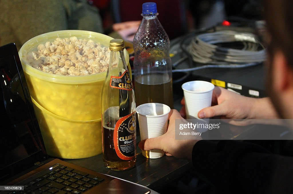 Pirate Party supporters drink Club Mate carbonated tea next to their bucket of popcorn during a meeting of the Berlin chapter of the party on February 23, 2013 in Berlin, Germany. After successes in 2011 in regional elections in the German capital and in the following year in the states of Schleswig-Holstein and North Rhine-Westphalia, the German Pirate Party (Piratenpartei), which initially focused on filesharing, censorship and data protection, has seen two of its state-level leaders in the states of Brandenburg and Baden-Wuerttemburg step down in the past few days alone. The party's Berlin representation is meeting over the weekend to choose its candidates for the country's federal elections, to be held on September 22, 2013, which will determine the 598 or more members of the 18th Bundestag, Germany's federal parliament. After well-publicized infighting in the party, many observers are skeptical that the party can reach the 5 percent vote required to join the country's politics on that level.