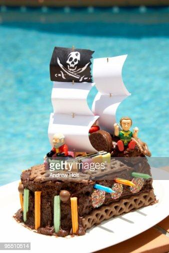 Pirate ship birthday cake by pool