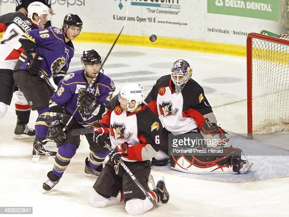 Pirates defenseman Mike Weber blocks a shot in front of goalie Jhonas Enroth while Gabe Gauthier of the Manchester Monarchs looks on Friday night at...