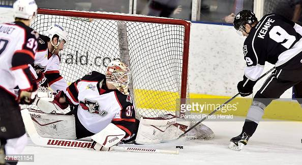Pirates goalie #37 Louis Domingue stops several attempts by Monarch Adrian Kempe as the Portland Pirates host the Manchester Monarchs in AHL playoff...
