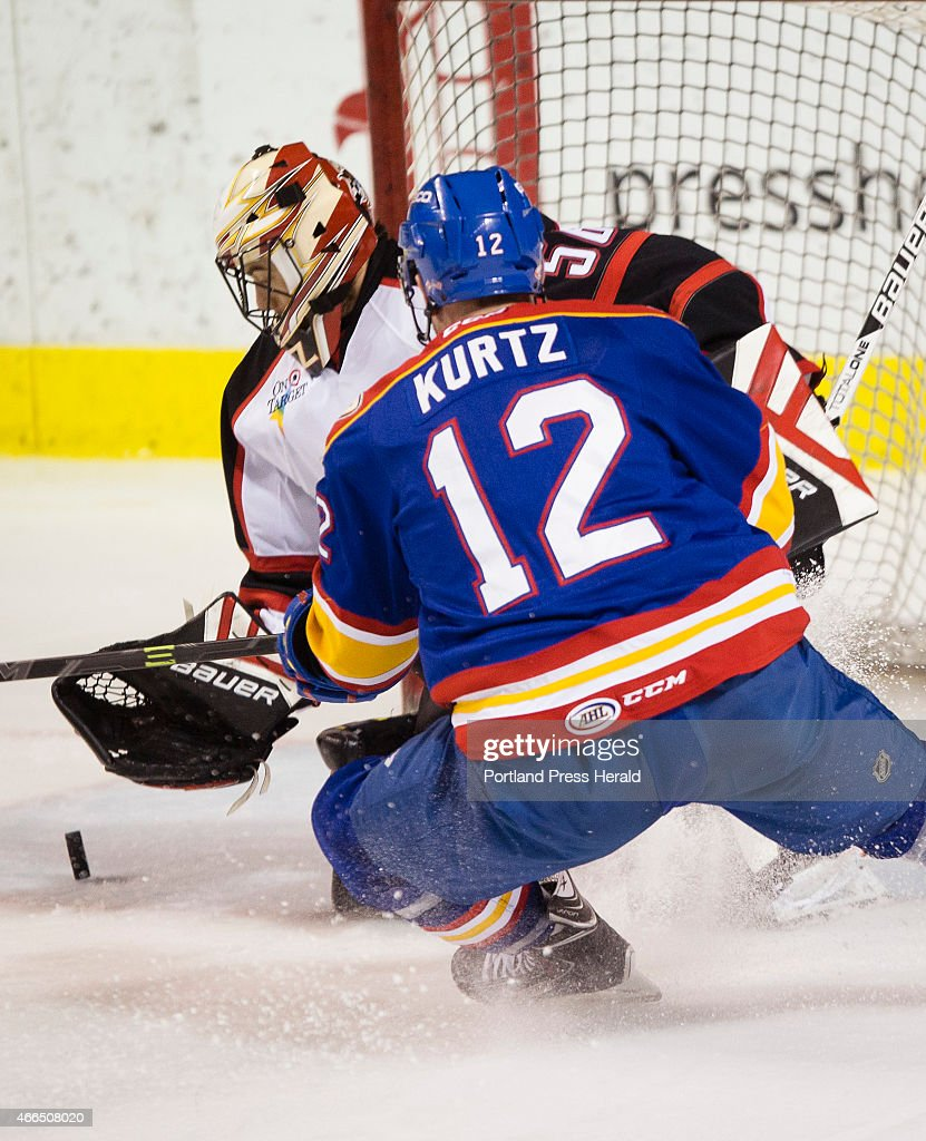 Pirates goalie Mike McKenna tries to glove a shot by Norfolk Admirals John Kurtz during AHL action at the Cross Insurance Arena