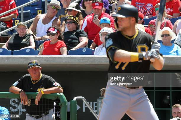 Pirates Manager Clint Hurdle watches his top prospect Austin Meadows while at bat during the spring training game between the Pittsburgh Pirates and...