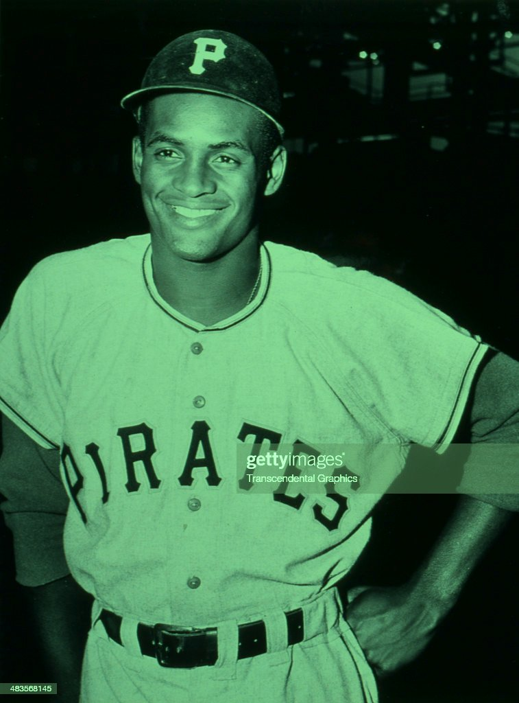 Pirates outfielder <a gi-track='captionPersonalityLinkClicked' href=/galleries/search?phrase=Roberto+Clemente&family=editorial&specificpeople=206918 ng-click='$event.stopPropagation()'>Roberto Clemente</a> grins at the camera before a game in 1961 at Forbes Field in Pittsburgh, Pennsylvania.