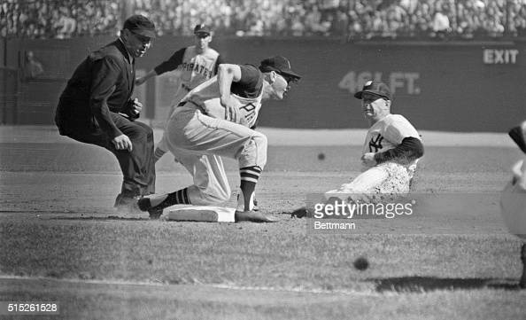 Pirates third baseman Don Hock puts the tag on Yankees Mickey Mantle here as umpire Johnny Stevens watches the play in the second inning of the third...