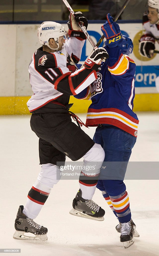 Pirates wing Francis Wathier and Norfolk Admirals wing Matt Bailey collide at center ice during AHL action at the Cross Insurance Arena