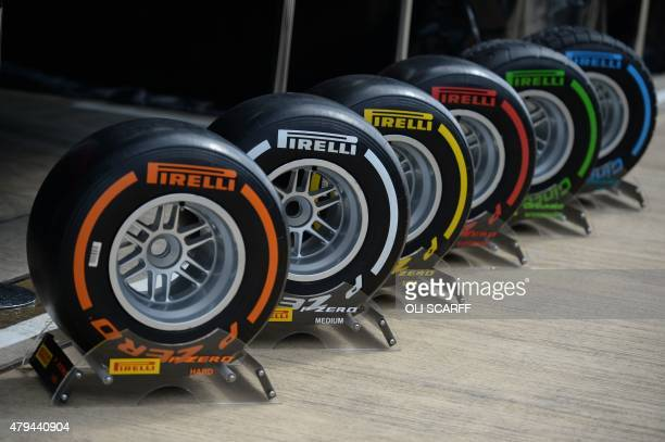 Pirelli Formula 1 tyres stand at their base in the paddock after the qualifying session at the Silverstone circuit in Silverstone on July 4 2015...