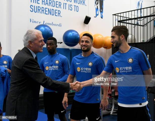 Pirelli Marco Tronchetti Provera and Roberto Gagliardini of FC Internazionale chat prior to the training session at Suning Training Center at Appiano...