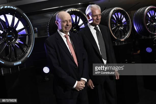 Pirelli's Executive Vice Chairman Marco Tronchetti Provera poses with CEO of Borsa Italiana Raffaele Jerusalmi during a ceremony to mark the comeback...