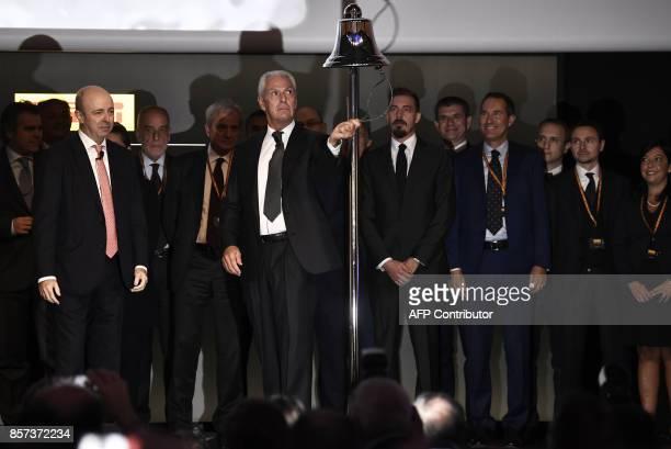Pirelli's Executive Vice Chairman Marco Tronchetti Provera rings the bell of Milan's stock exchange to mark the return of Italian tire maker Pirelli...