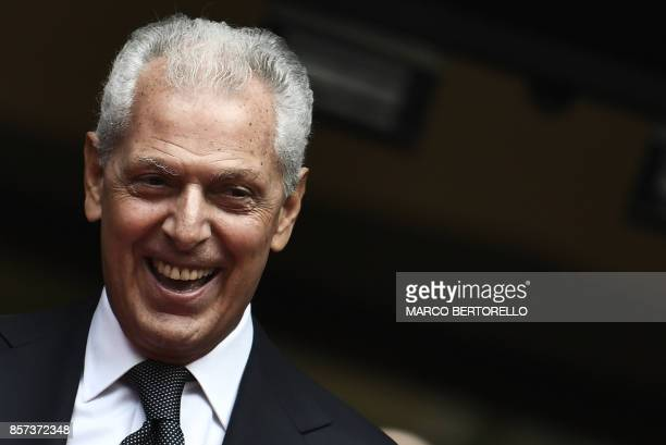 Pirelli's Executive Vice Chairman Marco Tronchetti Provera smiles after ringing the bell of Milan's stock exchange to mark the return of Italian tire...