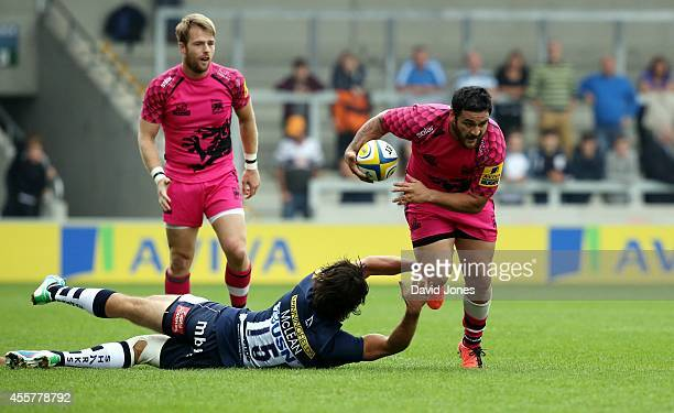 Piri Weepu of London Welsh evades Luke McLean of Sale Sharks during the Aviva Premiership match between Sales Sharks and London Welsh at A J Bell...