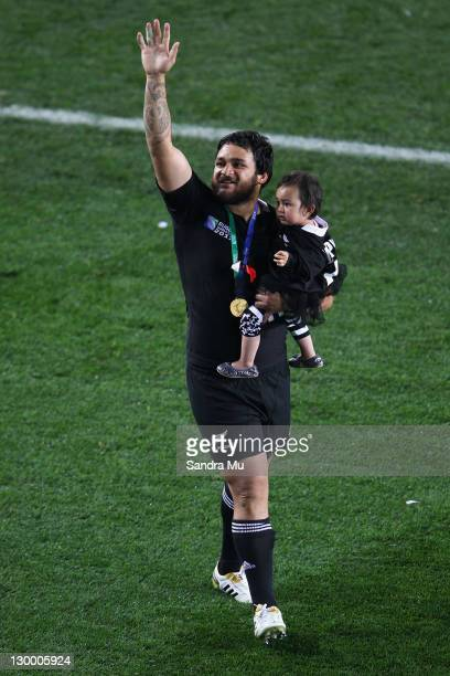 Piri Weepu of the All Blacks celebrates victory with his daughter Keira after the 2011 IRB Rugby World Cup Final match between France and New Zealand...