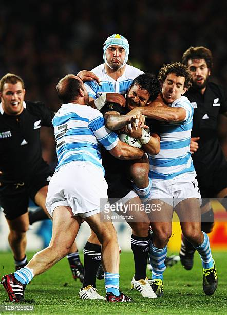 Piri Weepu of the All Blacks is stopped by the Argentina defense during quarter final four of the 2011 IRB Rugby World Cup between New Zealand and...
