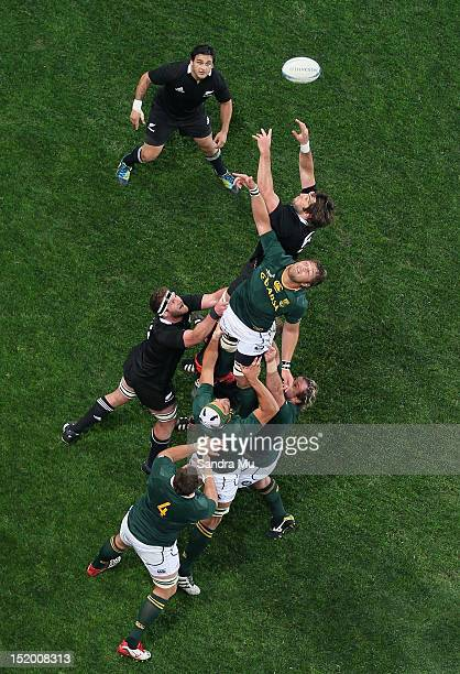 Piri Weepu of the All Blacks looks up as Sam Whitelock of the All Blacks and Duane Vermeulen of South Africa reach in the lineout during the Rugby...