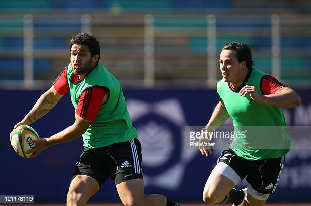 Piri Weepu of the All Blacks passes the ball with support from Zac Guildford during the New Zealand All Blacks Training Session at Xerox Arena on...