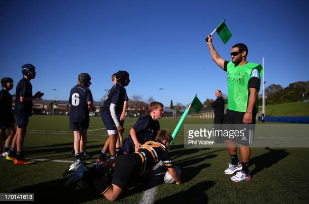 Piri Weepu of the All Blacks raises his flag as he attends the New Zealand Rugby APPLAUD Programme Launch at the College Rifles Rugby Club on June 8...