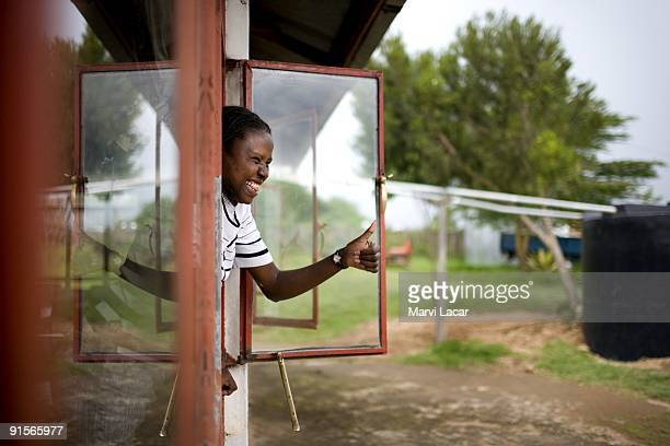 Pirias Jeniffer Kiok gestures to a friend at the Tasaru Safehouse for Girls December 25 2006 in Narok Kenya The Tasaru Safehouse supports board...